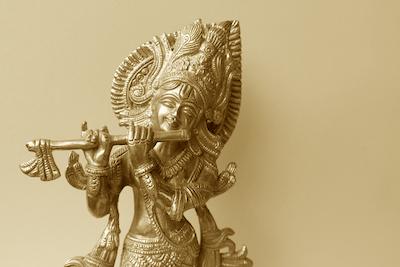 Krishna Plays his Flute